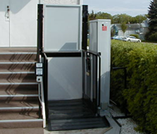 commercial accessible wheelchair platform lift installed in an open space